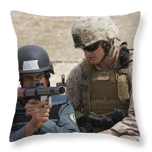 Soldier Throw Pillow featuring the photograph An Afghan Police Student Aiming A Rpg-7 by Terry Moore