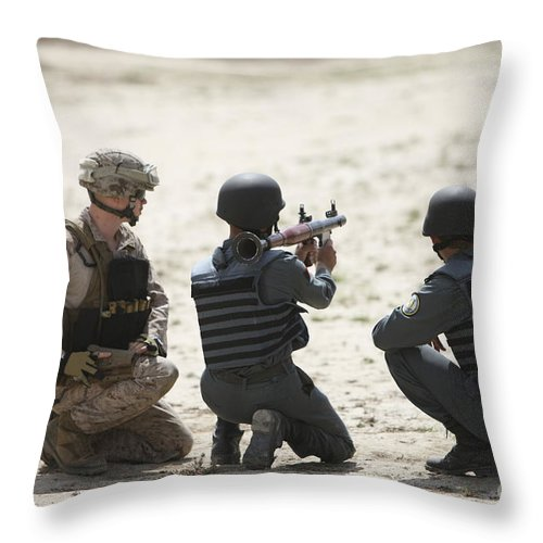 Afghanistan Throw Pillow featuring the photograph An Afghan Police Student Prepares by Terry Moore