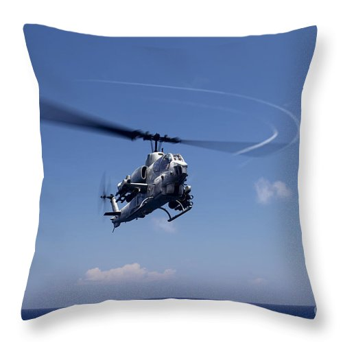 Ah-1 Cobra Throw Pillow featuring the photograph An Ah-1 Cobra In Flight by Stocktrek Images