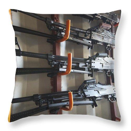 Pk Machine Gun Throw Pillow featuring the photograph An Armory Of Pk Machine Guns Designed by Terry Moore
