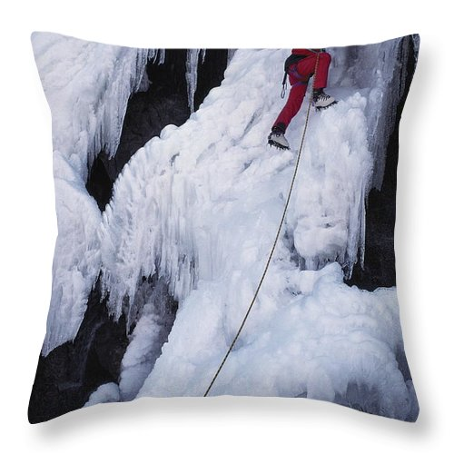 Model Released Photography Throw Pillow featuring the photograph An Ice Climber On Habeggers Falls by Gordon Wiltsie