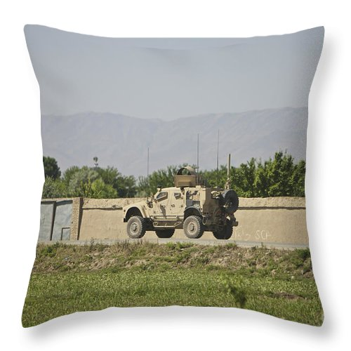 Afghanistan Throw Pillow featuring the photograph An M-atv Driving Towards Aliabad by Terry Moore
