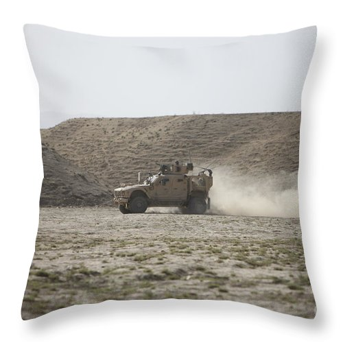 Kunduz Throw Pillow featuring the photograph An M-atv Races Across The Wadi by Terry Moore
