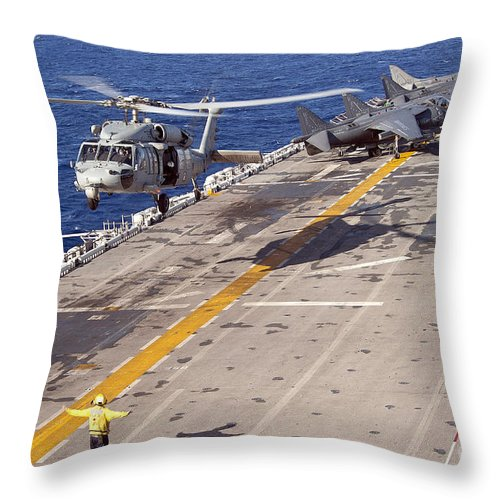 Underway Replenishment Throw Pillow featuring the photograph An Mh-60s Seahawk Helicopter Prepares by Stocktrek Images