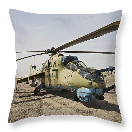 Camouflage Throw Pillow featuring the photograph An Mi-35 Attack Helicopter At Kunduz by Terry Moore
