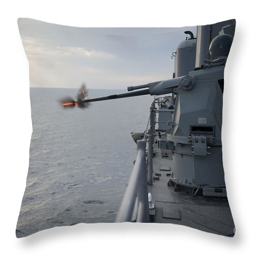 Weapon Systems Throw Pillow featuring the photograph An Mk38 Mod 2 25mm Machine Gun System by Stocktrek Images