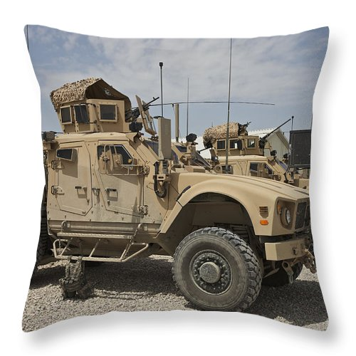 Afghanistan Throw Pillow featuring the photograph An Oshkosh M-atv Parked At A Military by Terry Moore