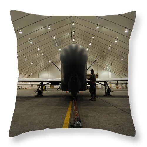 Military Throw Pillow featuring the photograph An Rq-4 Global Hawk Unmanned Aerial by Stocktrek Images