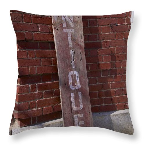 Signage Throw Pillow featuring the photograph Antiques by Allan Morrison