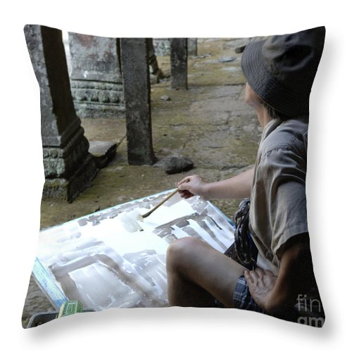 Cambodian Youth Throw Pillow featuring the photograph Artist At Ankor Wat by Bob Christopher