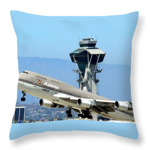 Lax Throw Pillow featuring the photograph Asiana 747-400 And Lax Tower by Jeff Lowe