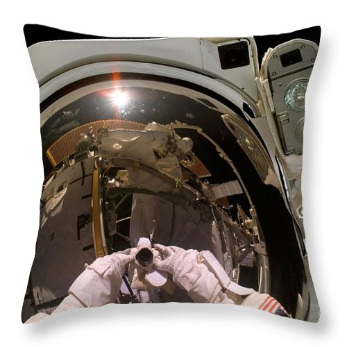 Astronaut Throw Pillow featuring the photograph Astronaut Takes A Self-portrat by Stocktrek Images