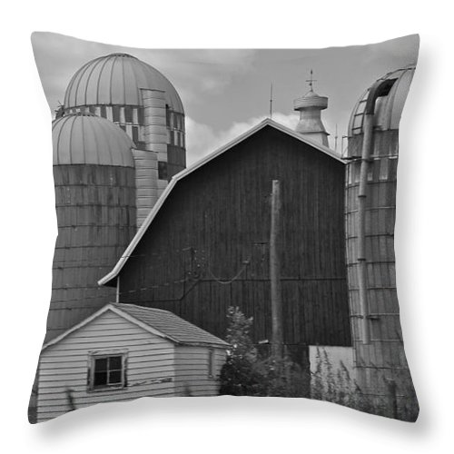Black And White Throw Pillow featuring the photograph Barns And Silos Black And White by Pamela Walrath