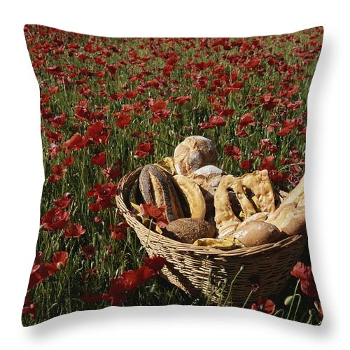 Europe Throw Pillow featuring the photograph Basket Of Bread In A Poppy Field by Nicole Duplaix