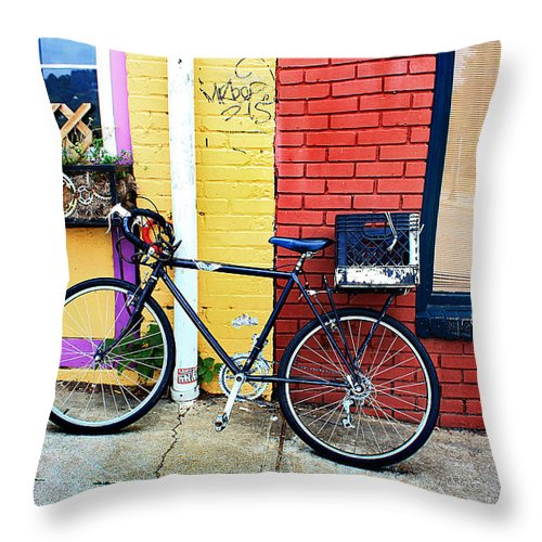 Bike Throw Pillow featuring the photograph Bike Leaning On The Colorful City Walls Of Asheville by Gray Artus