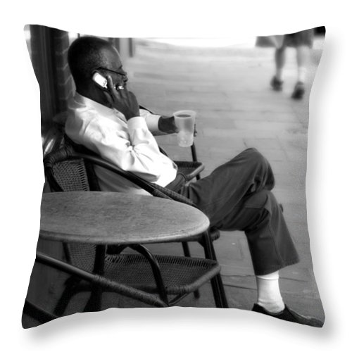 Street Photography Throw Pillow featuring the photograph Black Man Relaxing On Sidewalks Of Asheville by Gray Artus