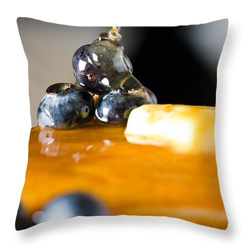 Berries Throw Pillow featuring the photograph Blueberry Butter Pancake With Honey Maple Sirup Flowing Down by U Schade