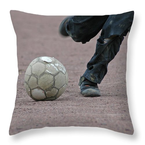 Ball Throw Pillow featuring the photograph Boy Playing Soccer With A Ball by Matthias Hauser