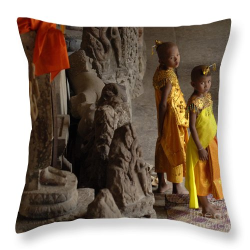 Cambodian Youth Throw Pillow featuring the photograph Cambodian Youths by Bob Christopher