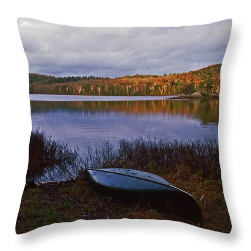 Canoe Throw Pillow featuring the photograph Canoe At Black Lake by David Edward Burton