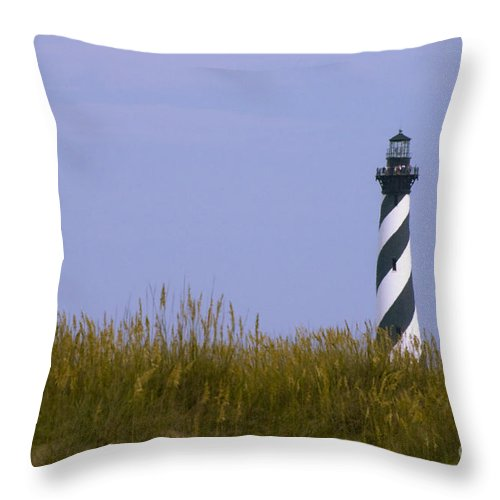 Lighthouse Throw Pillow featuring the photograph Cape Hatteras Lighthouse And Seagrass by Tim Mulina