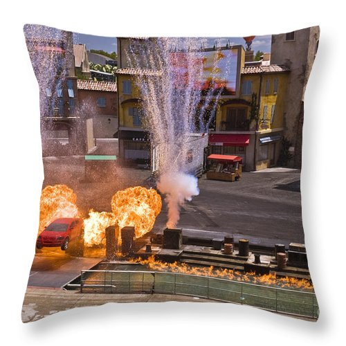 Disney World Throw Pillow featuring the photograph Car And Explosions At Disney Hollywood by Tim Mulina