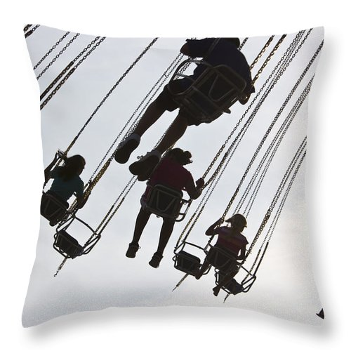 Color Image Throw Pillow featuring the photograph Carnival Goers Enjoy A Ride At An by Stacy Gold