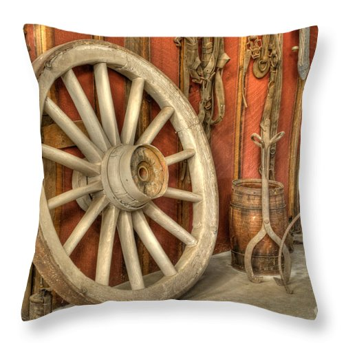 Wheel Throw Pillow featuring the photograph Chariot Wheel by Diego Re