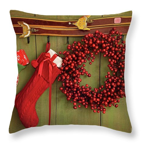 Antique Throw Pillow featuring the photograph Christmas Stockings And Wreath Hanging On Wall by Sandra Cunningham