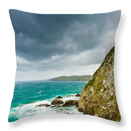 Background Throw Pillow featuring the photograph Cliffs Under Thunder Clouds And Turquoise Ocean by U Schade