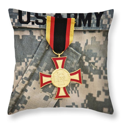 Operation Enduring Freedom Throw Pillow featuring the photograph Close-up View Of A German Gold Cross by Terry Moore