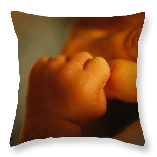 Model Released Photography Throw Pillow featuring the photograph Close View Of The Hands Of An Infant by Raul Touzon