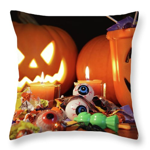 Abundance Throw Pillow featuring the photograph Closeup Of Candies With Pumpkins by Sandra Cunningham