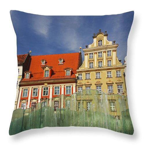 Buildings Throw Pillow featuring the photograph Colourful Buildings And Fountain by Trish Punch