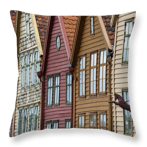 Brown Throw Pillow featuring the photograph Colourful Houses In A Row Bergen Norway by Keith Levit