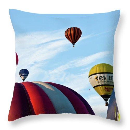 Balloons Throw Pillow featuring the photograph Coming Through by Brian Roscorla