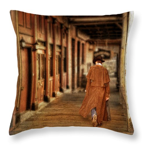 Cowboy Boots Throw Pillow featuring the photograph Cowboy In Old West Town by Jill Battaglia