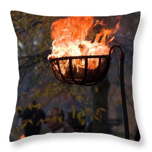 Cresset Burning Throw Pillow featuring the photograph Cresset Giving Light by Sally Weigand