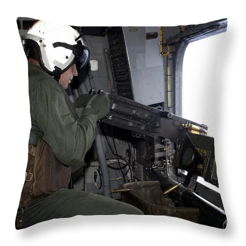 50 Caliber Throw Pillow featuring the photograph Crew Chief Fires An M2 .50-caliber by Stocktrek Images