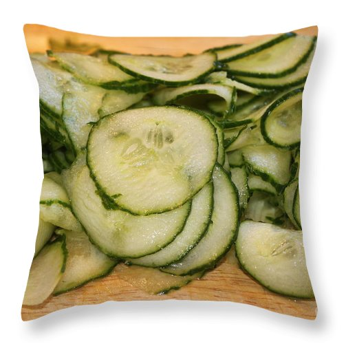 Meal Throw Pillow featuring the photograph Cucumbers by Henrik Lehnerer