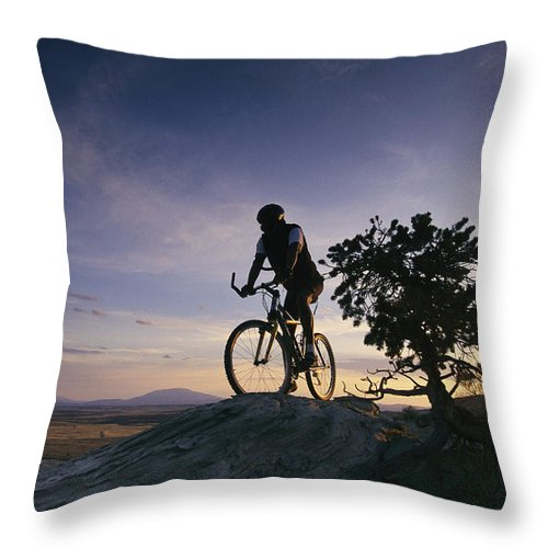 North America Throw Pillow featuring the photograph Cyclist At Sunset, Northern Arizona by David Edwards