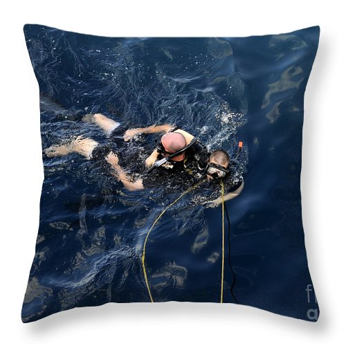 Diving Mask Throw Pillow featuring the photograph Damage Controlman Performs Training by Stocktrek Images