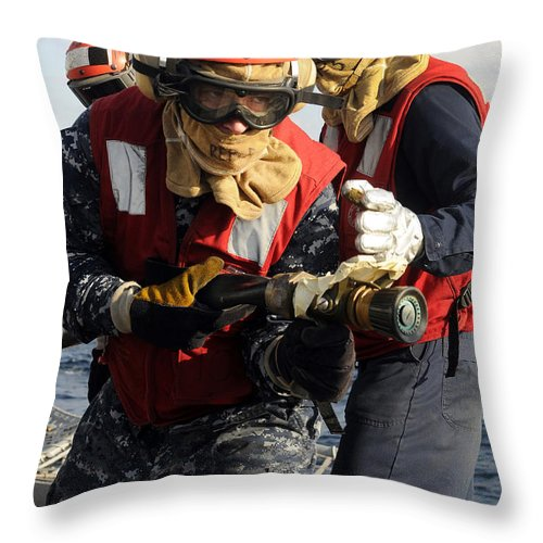Firefighter Throw Pillow featuring the photograph Damage Controlman Practices by Stocktrek Images