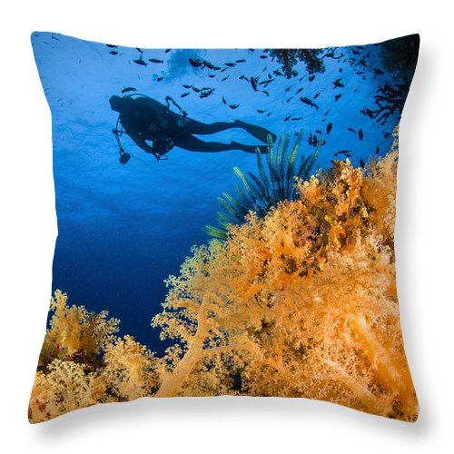 Crinoid Throw Pillow featuring the photograph Diver Swimms Above Soft Coral, Fiji by Todd Winner