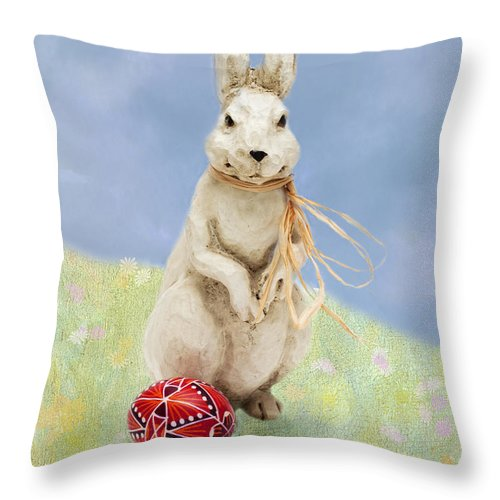 Easter Throw Pillow featuring the photograph Easter Bunny With A Painted Egg by Louise Heusinkveld
