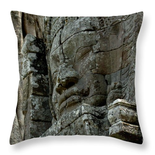 Cambodian Youth Throw Pillow featuring the photograph Face Of Stone by Bob Christopher