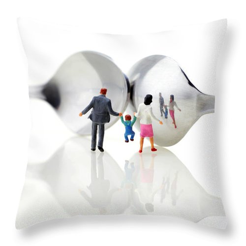 Family Throw Pillow featuring the photograph Family In Front Of Spoon Distoring Mirrors II by Paul Ge