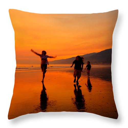 Photography Throw Pillow featuring the photograph Family Running In The Beach At Sunset by Jorge Fajl