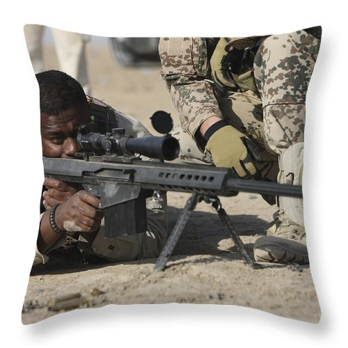 Operation Enduring Freedom Throw Pillow featuring the photograph Fijian Contractor Firing A Barrett by Terry Moore