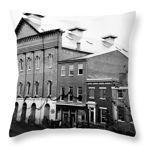 fords Theater Throw Pillow featuring the photograph Fords Theater - After Lincolns Assasination - 1865 by International Images